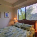 Queen bed in guest bedroom