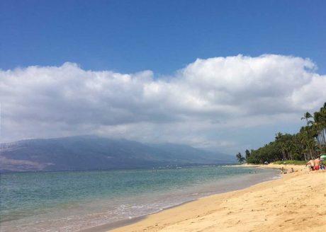 Waiohuli Beach Hale is situated on a white sandy beach.